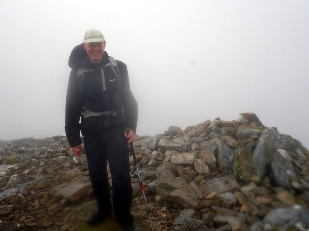 You need a sense of humour to go up hills in Scotland, and a good memory for unpronounceable mountain names. Here's my summit photo on top of Beinn Liath Mhor Fannaich.