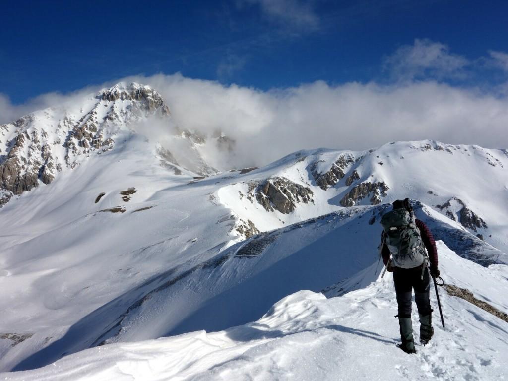 Traversing the ridge above Campo Imperatore with Corno Grande up ahead