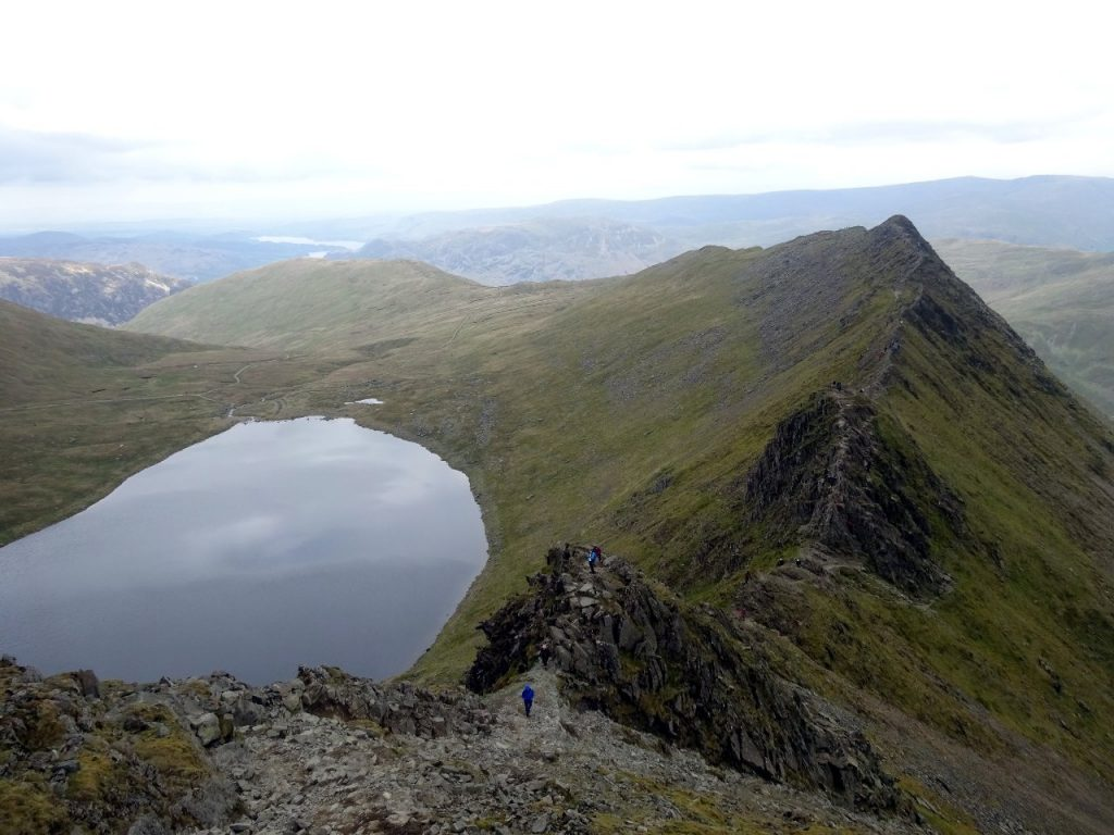 Striding Edge from the top of Helvellyn, with the glacier-scoured lake of Red Tarn below
