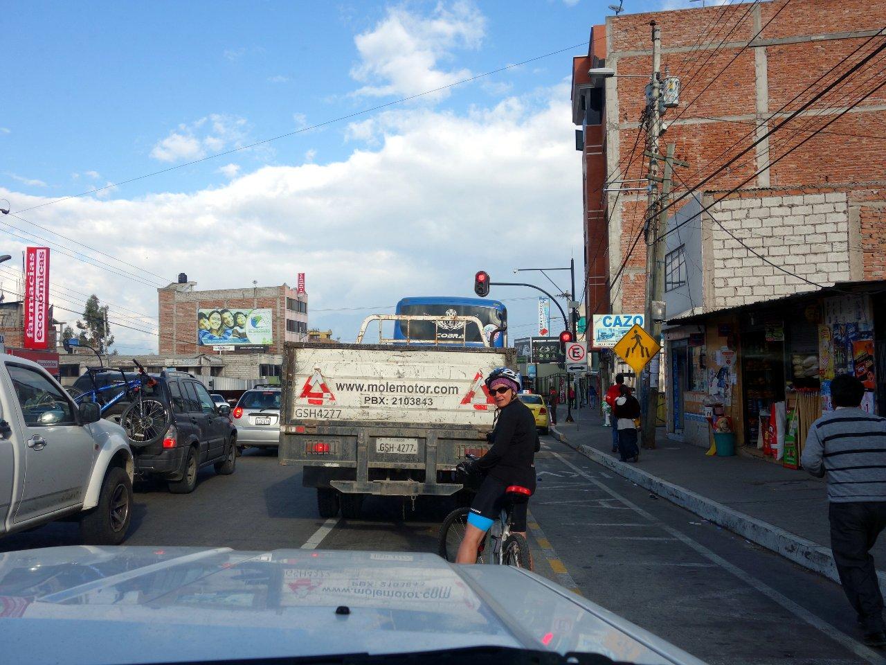 Edita stops at a traffic light on her ride through Riobamba