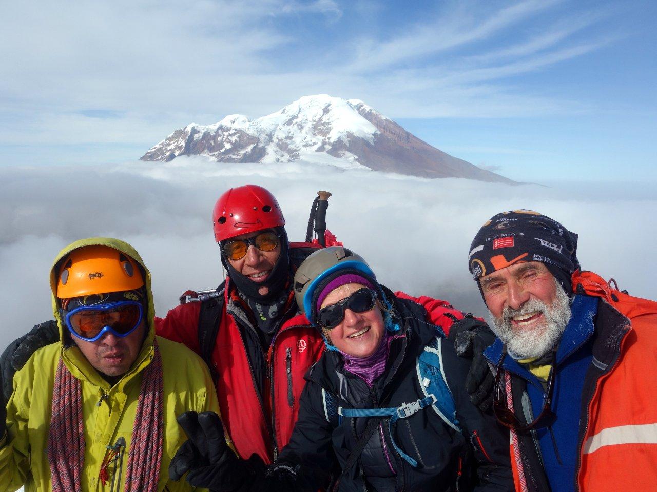 Javier, Marco, Edita and Rodrigo beneath the summit of Carihuairazo, with Chimborazo floating above the clouds
