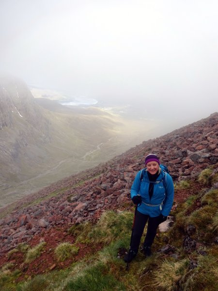 Edita on her way up the steep side of Carn Mor Dearg, with Coire Leis below
