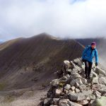 Edita on the arete, with Carn Mor Dearg behind