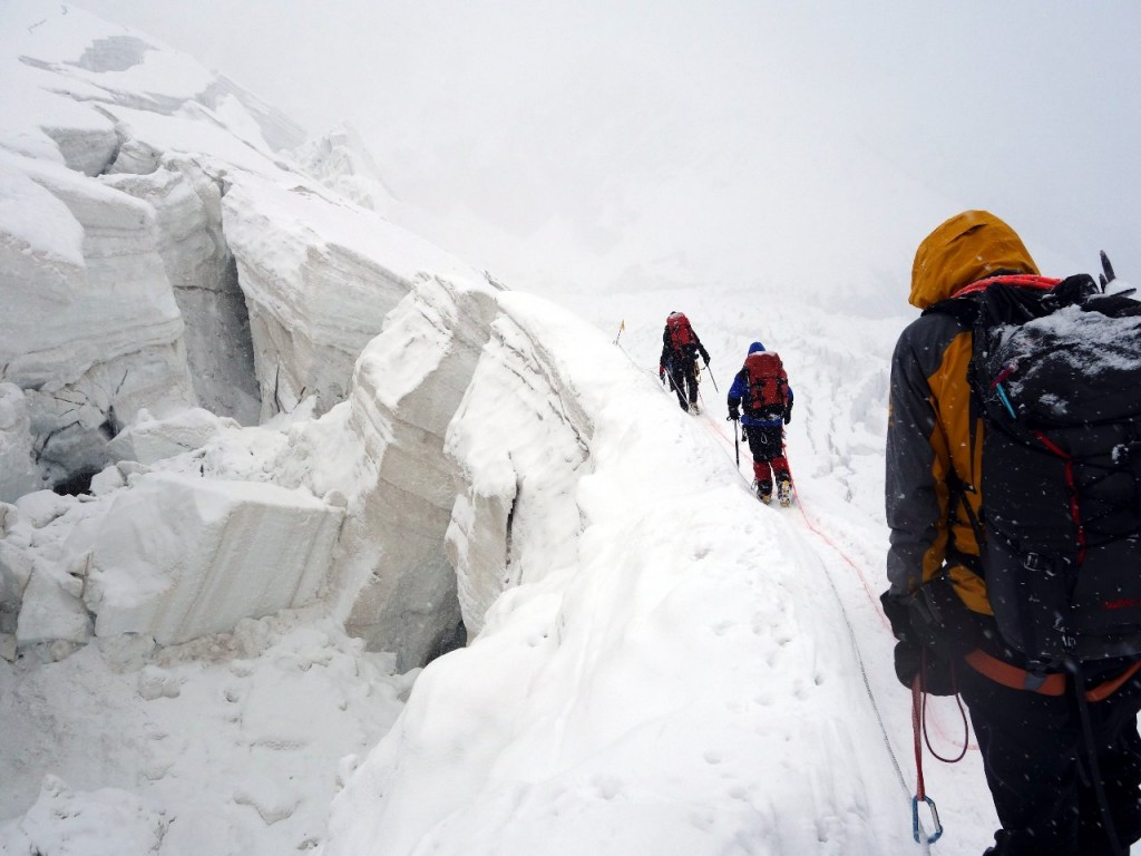 Crevasses and seracs in damp grey mist on the descent to Camp 1