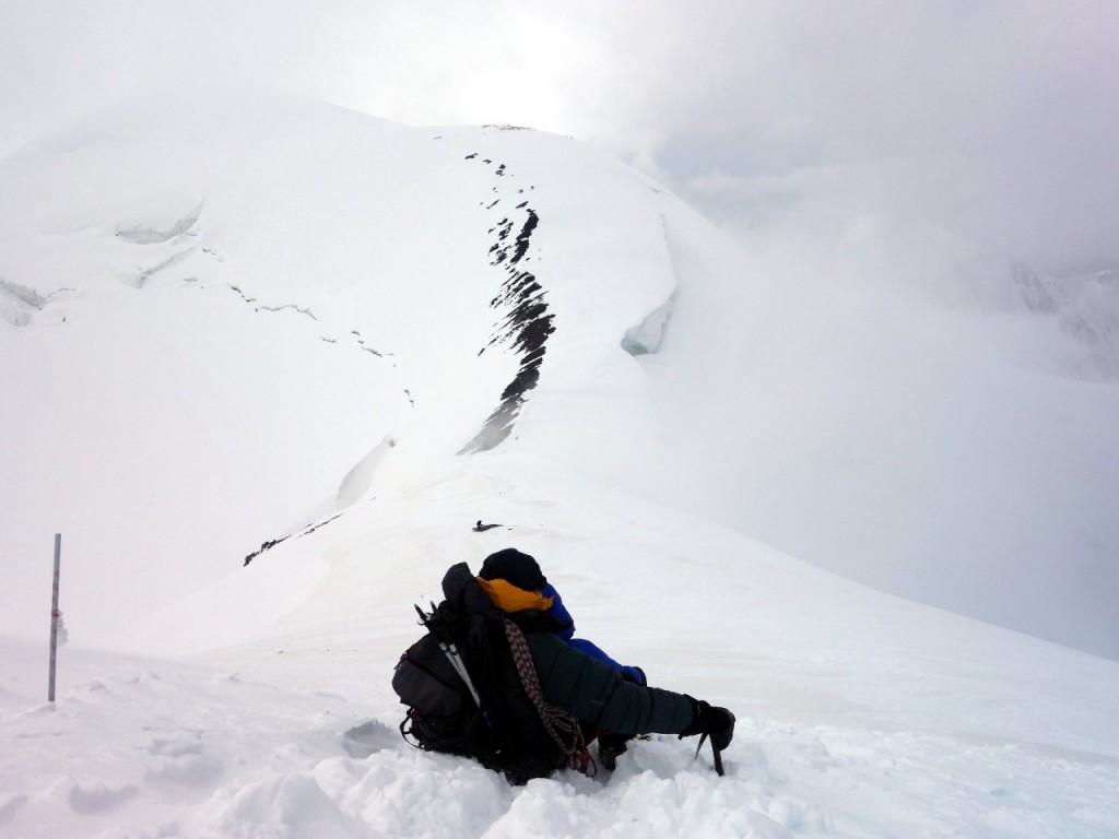 Resting in a bed of snow and contemplating the climb back up to Camp 3