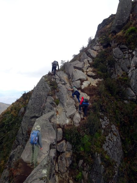 Scrambling up an exposed section on the main summit of Fuya Fuya