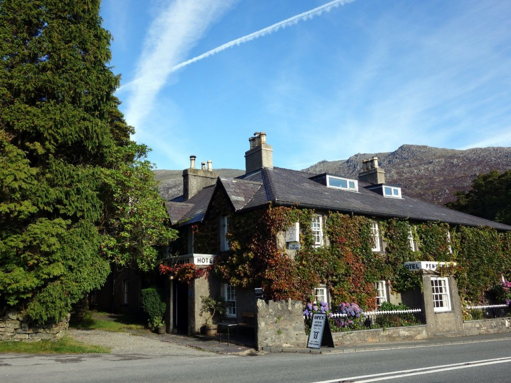 The Pen-y-Gwyrd Hotel stands by the roadside at the foot of Snowdon