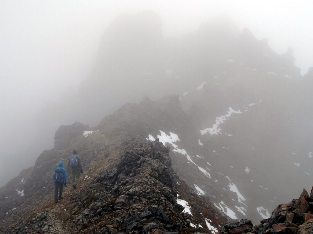 In mist on the crater rim