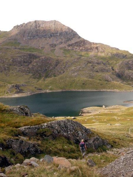 Descending into Cwm Dyli, with Crib Goch seen across the waters of Llyn Llydaw