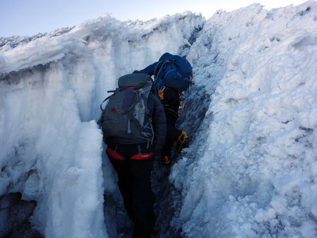 Squeezing through the first section of penitentes on the approach to Cumbre Veintimilla