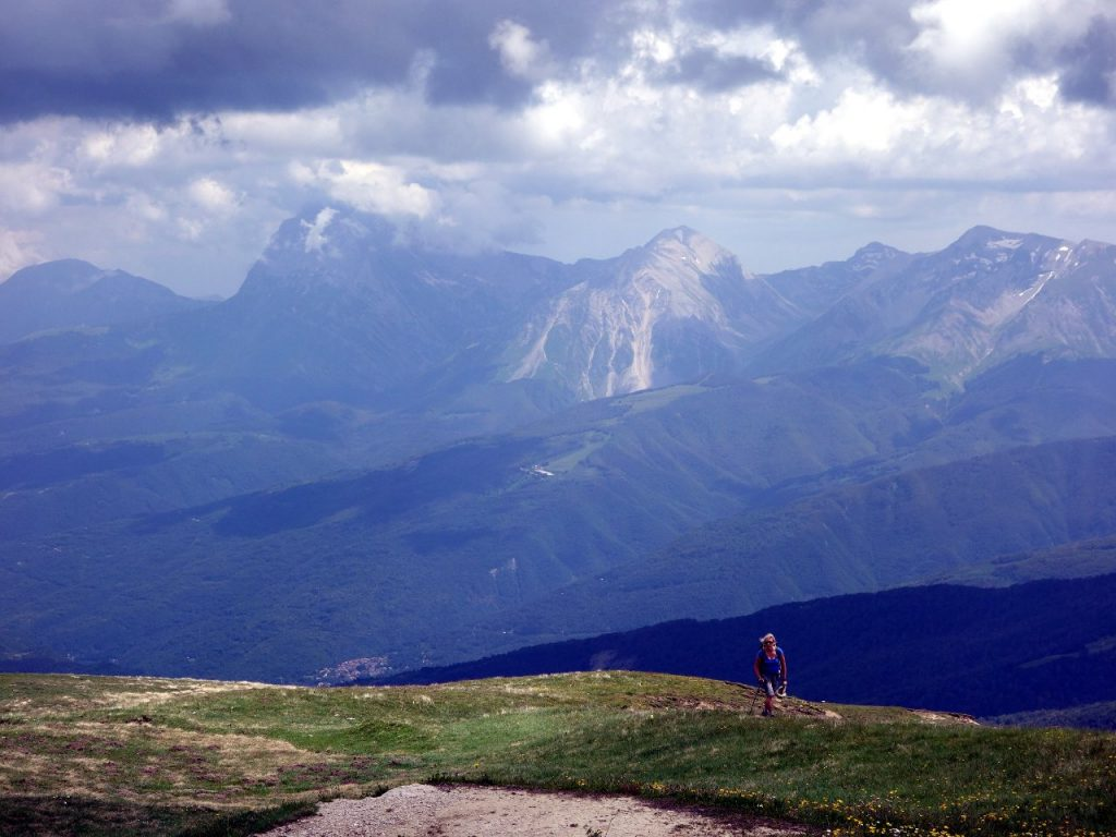 Edita approaching the summit of Monte Gorzano, with the Gran Sasso massif behind