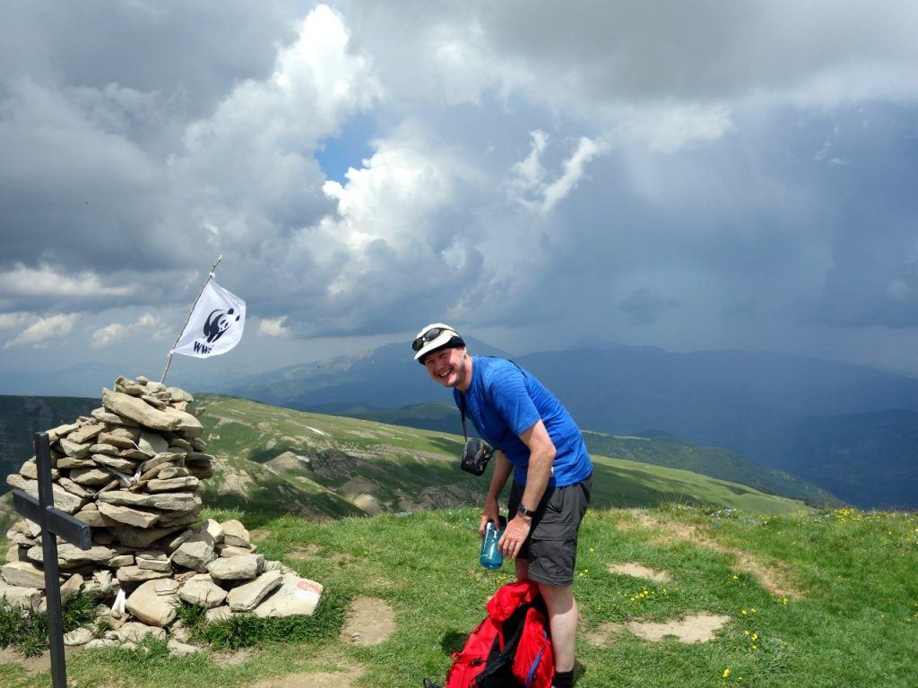 On the summit of Monte Gorzano, with a thunderstorm raging over the mountains behind