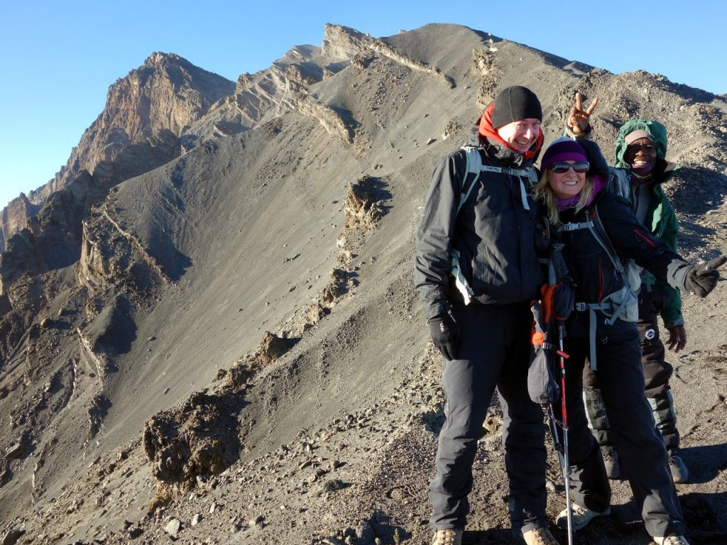 Me, Edita and Joseph during the descent, with the summit and summit ridge behind us