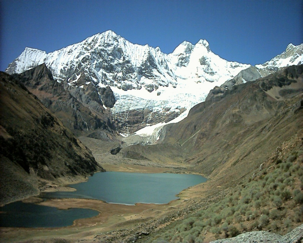 The stunningly beautiful Cordillera Huayhuash, with its turquoise glacial lakes nestling beneath dramatic towering ice peaks. Here are Rondoy and Jirishanca seen across Laguna Jahuacocha.