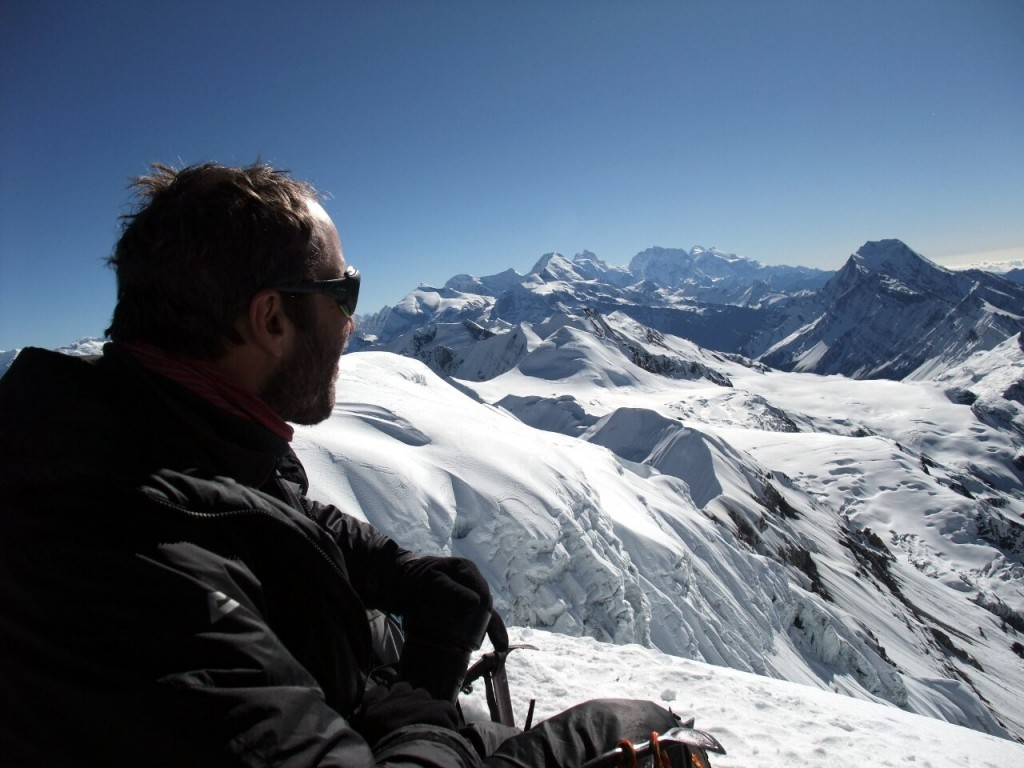 Mark Dickson contemplates Manaslu on the horizon from the summit of Chulu Far East in the Annapurna region of Nepal