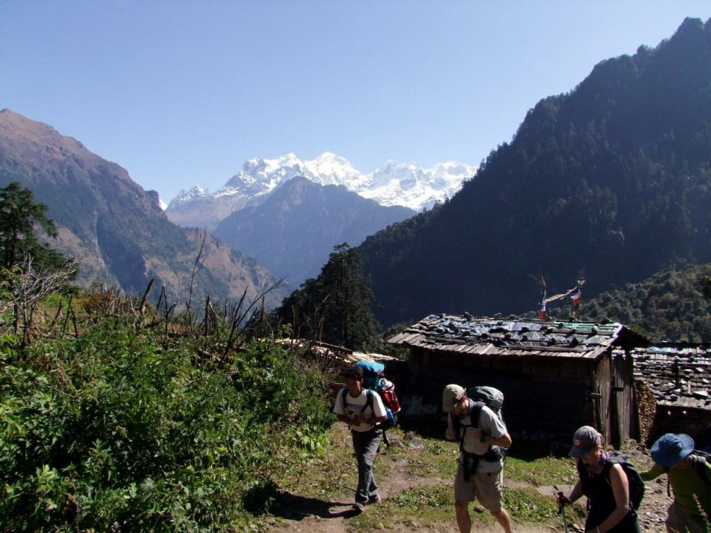Trekkers in Timang on the Annapurna Circuit, with Manaslu behind