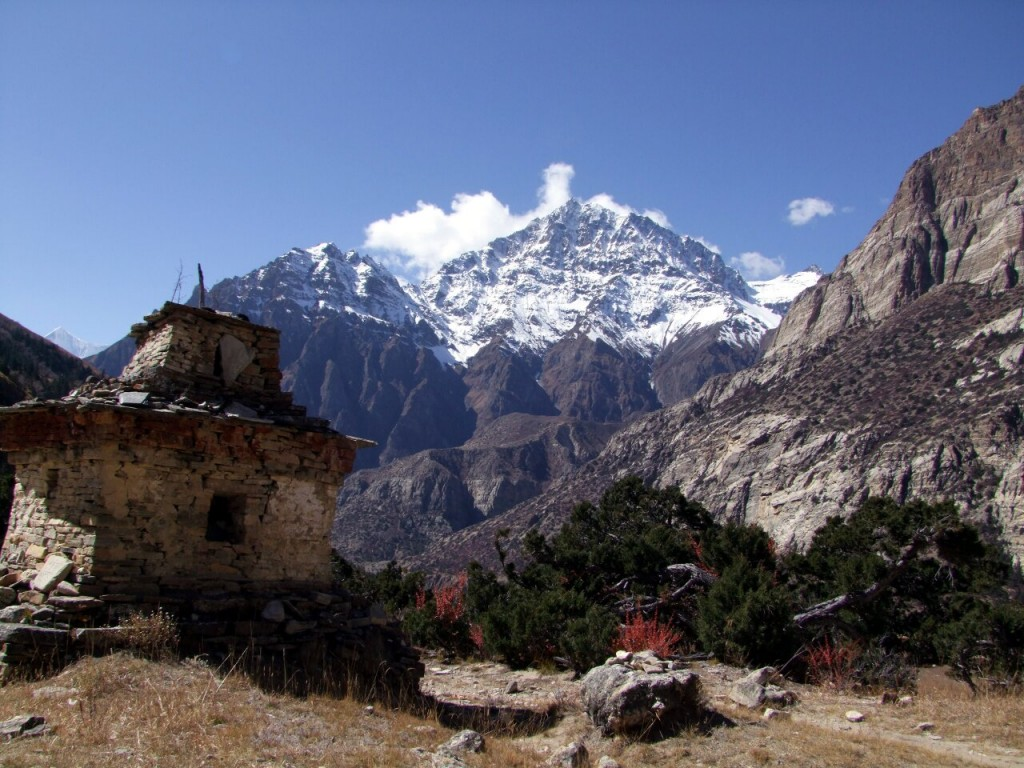 Buddhist stupa, juniper bushes and Pisang Peak in the land of Naar and Phu