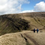 Walkers on the Mynydd Du escarpment