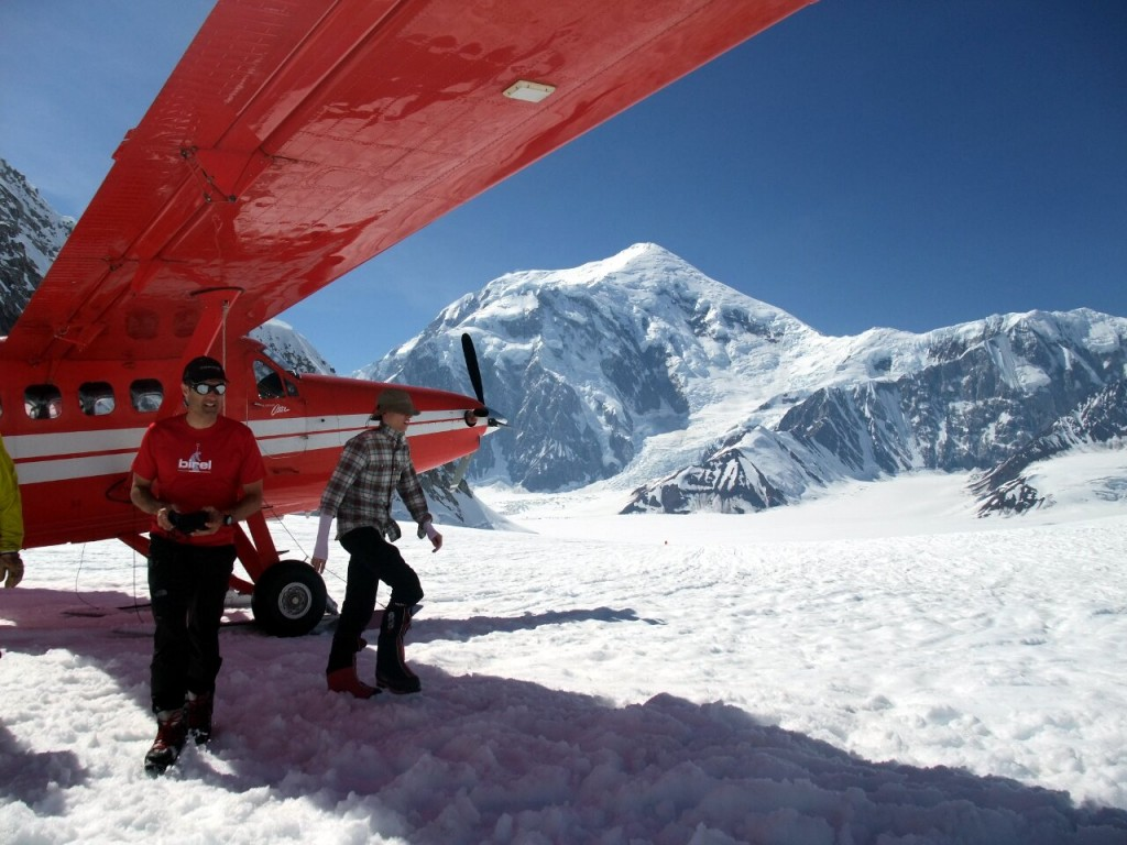 Twin Otter aircraft on the Kahiltna Glacier with Mount Foraker (5304m) behind