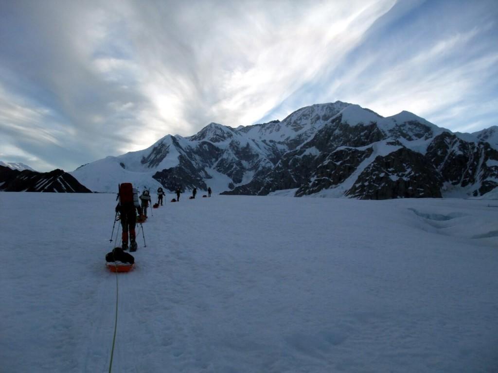 Night time sledge pulling on the Kahiltna Glacier