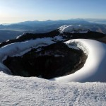 Staring down into Cotopaxi's volcanic crater is an unforgettable experience