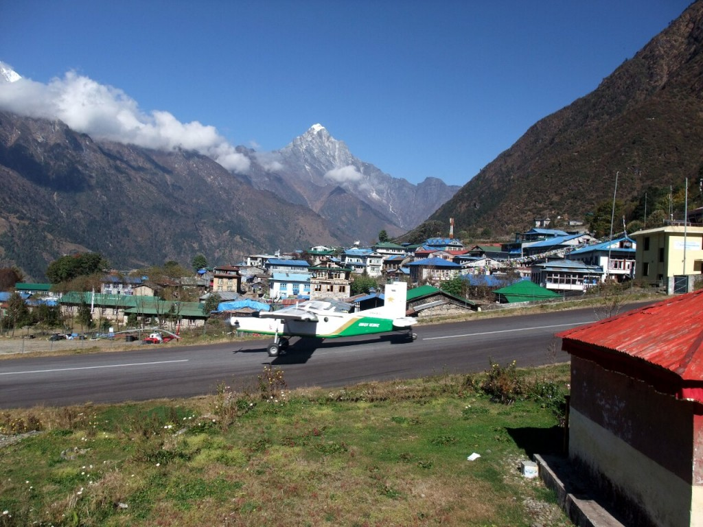 Twin Otter plane on the steep runway at Lukla
