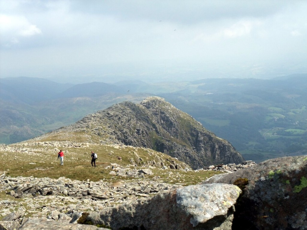 Figures approach Moel Siabod's summit from its east ridge