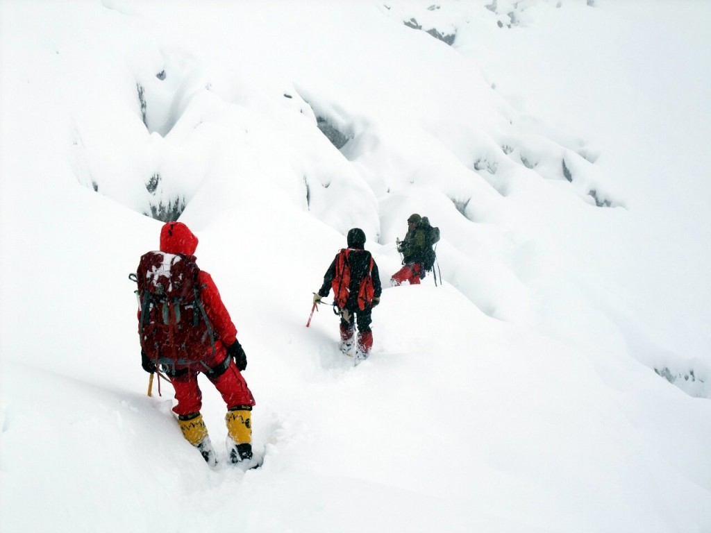 Mila, Anne-Mari and Gombu negotiate crevasses during the retreat to base camp