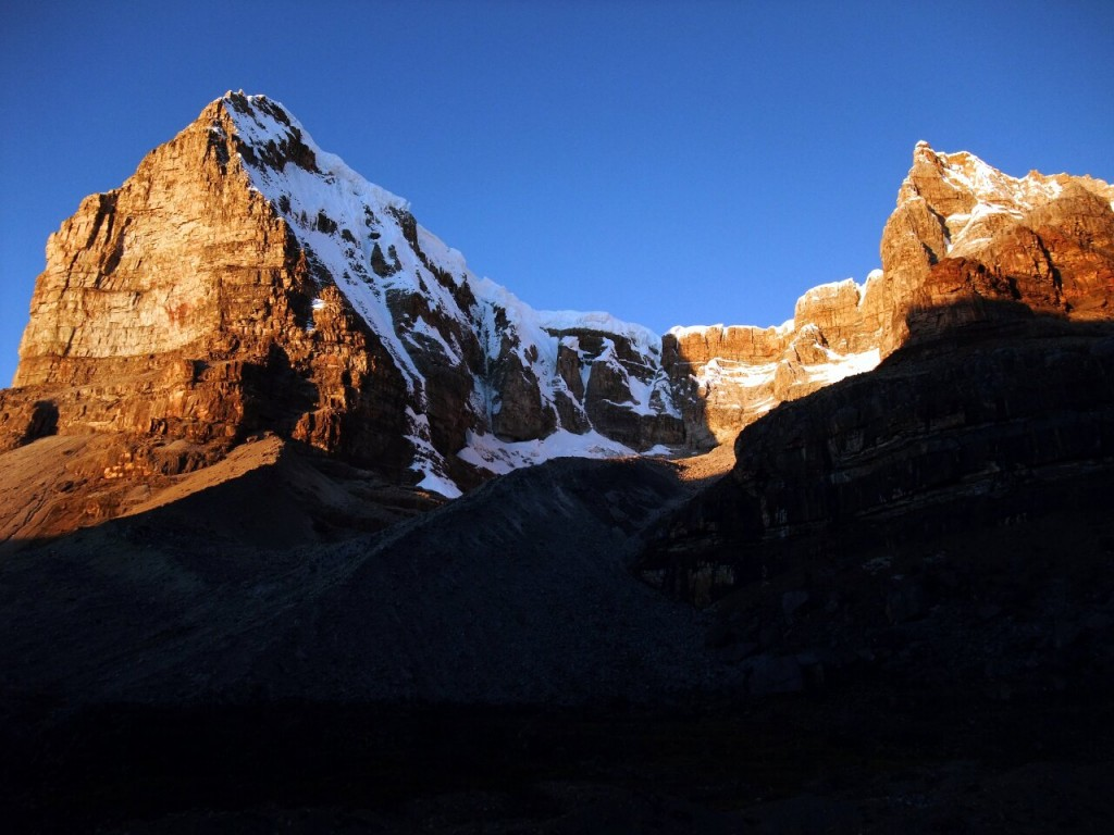 Dawn view of Ritacuba Blanco (5410m) and Ritacuba Negro (5250m) from Laguna del Avellanal