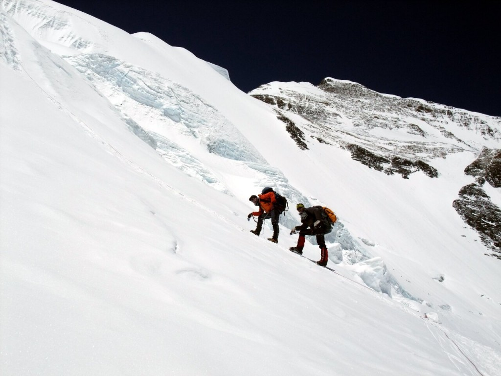 Sherpas rest with heavy loads on their way up to Everest's North Col