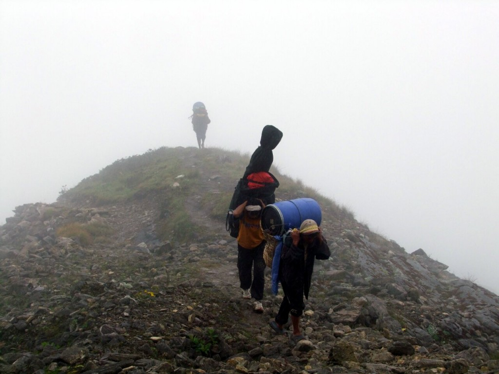These porters knew they were approaching Manaslu Base Camp when it started raining