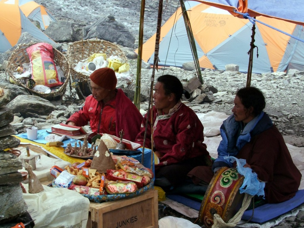 Buddhist monks conduct a puja at Manaslu Base Camp, Nepal