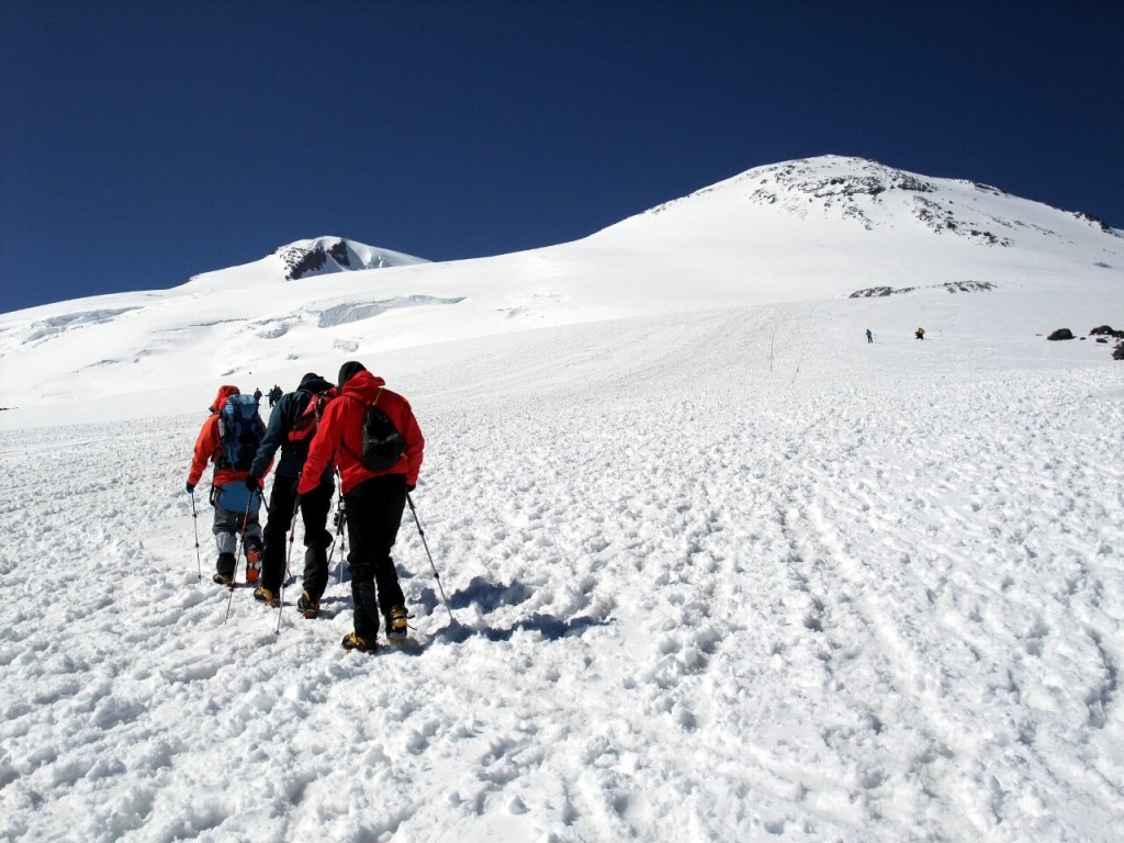 Walking slowly up Elbrus with West Peak (5642m) left and East Peak (5621m) right