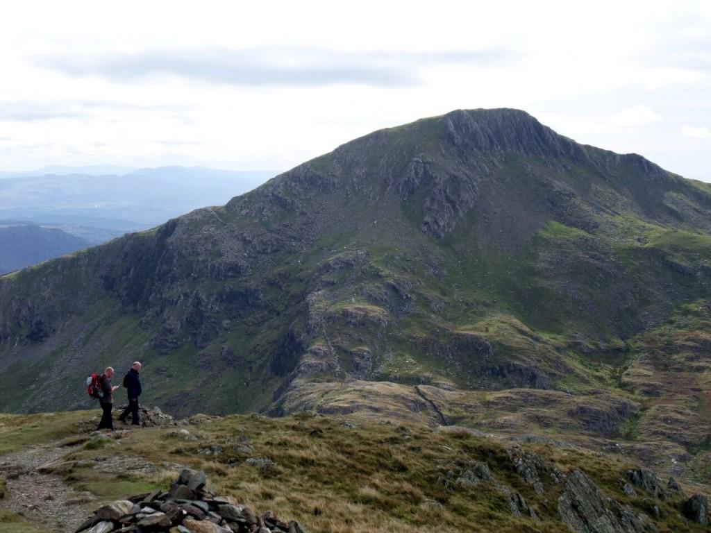 Walkers above Bwlch Cwm Llan, with Yr Aran behind