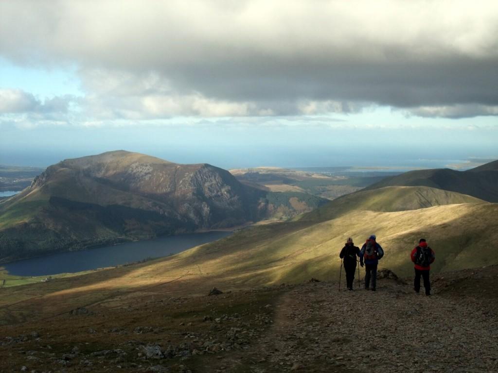 Walkers on the Snowdon Ranger Path, with Mynydd Mawr below
