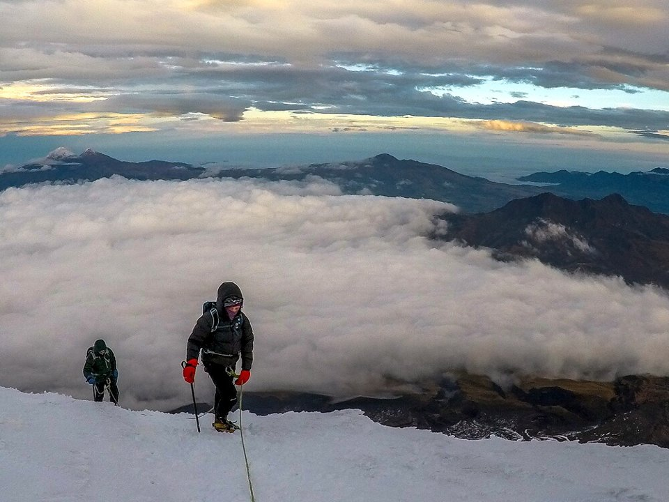 Edita approaches the summit, with the Ilinizas and Corazon behind (Photo: Estalin Suarez)