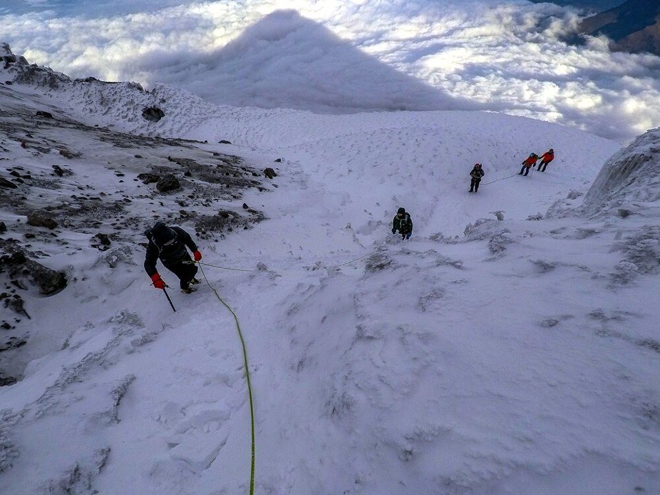The shadow of Cotopaxi's summit cast into the snow beneath (Photo: Estalin Suarez)