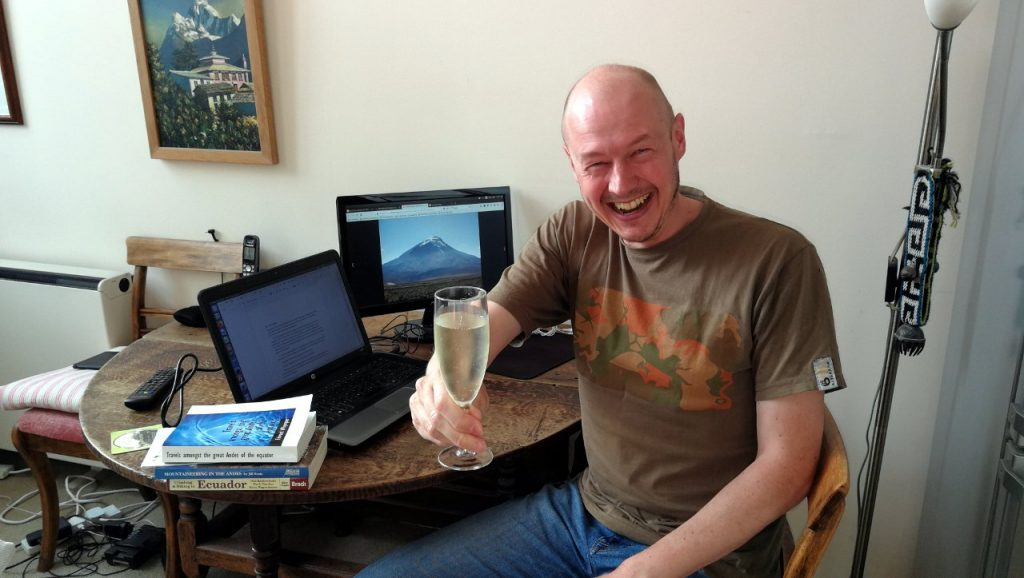 Cheers! A wee glass of prosecco to celebrate finishing the first draft. I look quite pleased.
