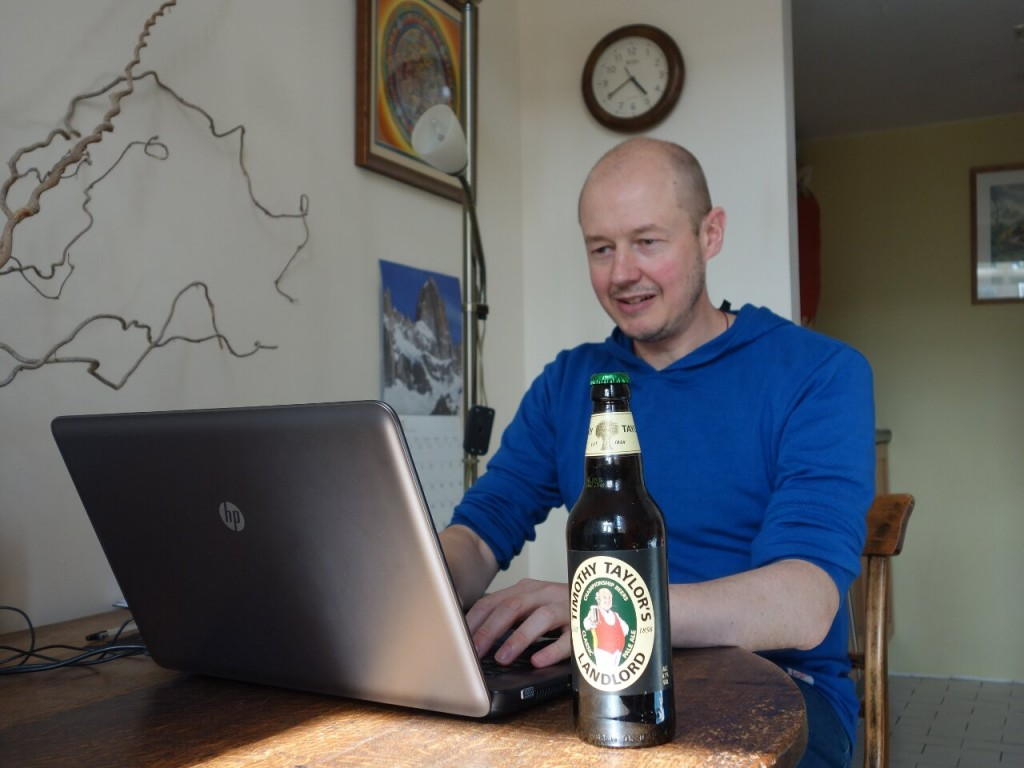 Here I am tapping away at the first draft. I'm not allowed the beer until I've written at least 2,000 words.