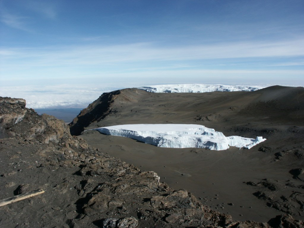 Kilimanjaro's glaciers are shrinking, and the Furtwangler Glacier in its summit crater looks like it's about to creep over the edge