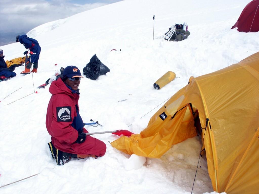 Gyalzen Sherpa at Camp 2 on Muztag Ata, clearing up on the way down