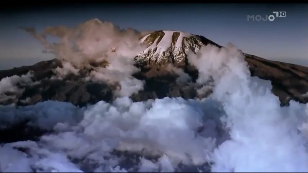 Kibo, Kilimanjaro's central peak, as pictured in the film, with its familiar carpet of cloud below