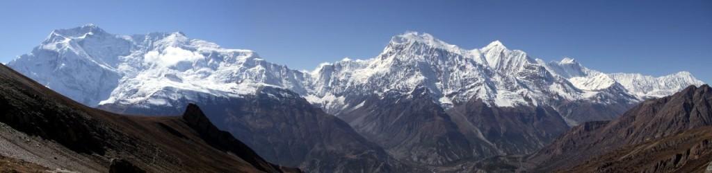 Panorama of Annapurna II (7939m), Annapurna IV (7525m), Annapurna III (7555m), Gangapurna (7454m), Annapurna I (8091m) and Tilicho Peak (7134m) seen across the Marsyangdi valley from below the Kang La