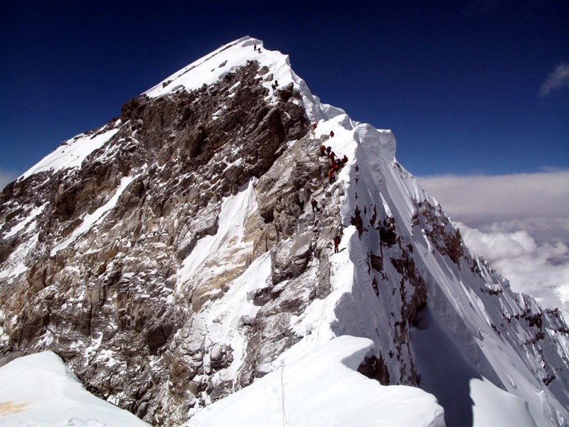 The South-East Ridge from the South Summit. The Hillary Step is the black rock section on the ridge just below the final summit snow slope (Photo: Anselm Murphy).