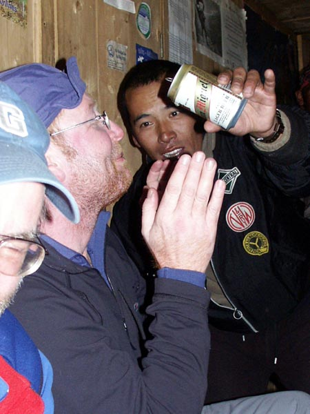 Sherpa hospitality: after our ascent of Mera Peak in 2004 we were made to drink alcohol by our Sherpa hosts in Tangnag