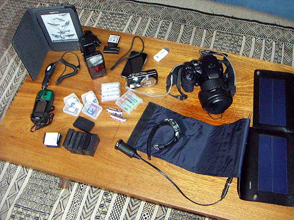 Cameras, batteries, chargers, adaptors, memory cards, phone, GPS, solar panel, Kindle - do we really need it all when we travel?