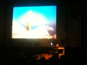 Kurt Diemberger shows a photo of Hermann Buhl on the summit of Broad Peak during its first ascent