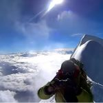 A frame from the above video, with a snowy ridge and two more summits behind (Photo: tokyo hutte / YouTube)