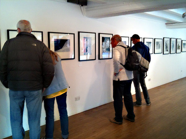 Visitors examine photographs from the 1953 Everest expedition at an exhibition in the Oxo Gallery