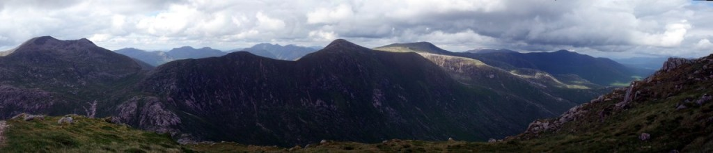 Panorama of Ben Starav, Glas Bheinn Mhor (foreground, middle), Stob Coir an Albannaich (in sunlight) and Stob Ghabhar (background, right) from Beinn nan Aighenan